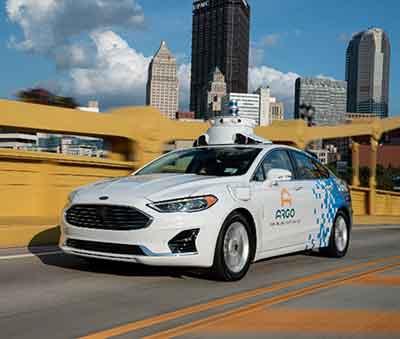 ARGO Autonomous vehicle driving accross city bridge.