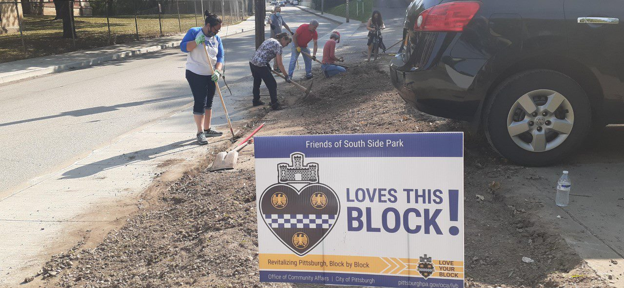 Volunteers working on South Side Park Mission Street entrance project