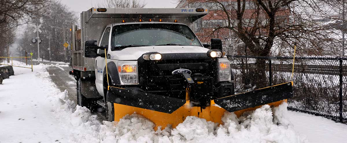 Image of Plow Truck plowing snow.