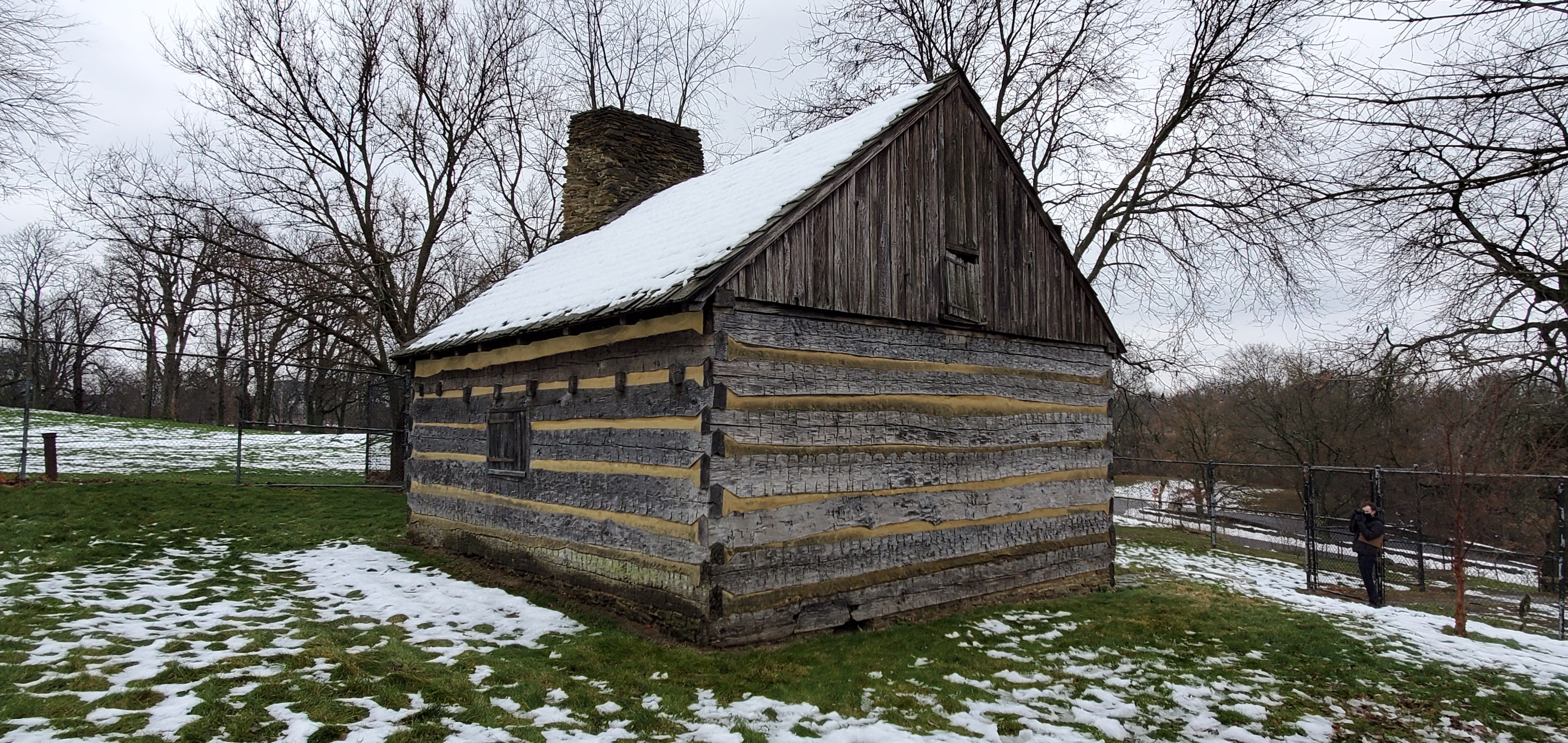 Neill Log House in present day with snow around the log house