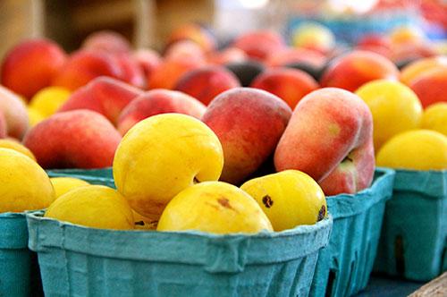 Photo of fresh picked fruit in a farmers market basket